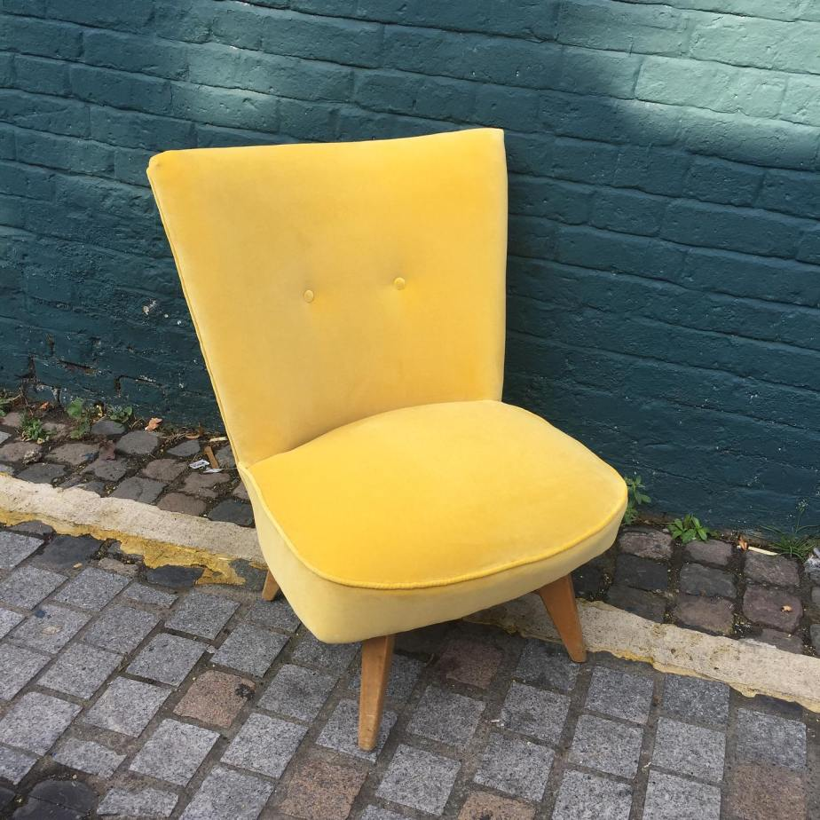 This image has an empty alt attribute; its file name is yellow-velvet-buttoned-cocktail-chair-after-1.jpg